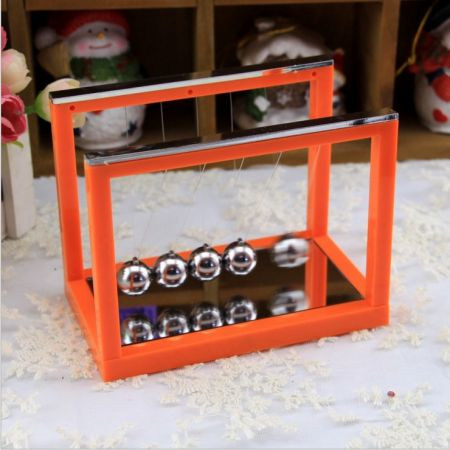 Шары ньютона на оранжевой подставке с зеркалом 16х11.7х8.5см